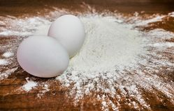 Flour with eggs on the table royalty free stock photos