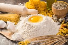 Flour, eggs, wheat still-life Stock Image