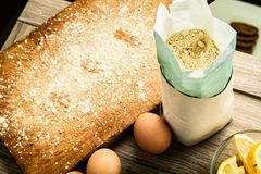 Flour and eggs on woodem table. Soy flour and eggs on woodem table top view Stock Photography