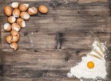 Flour eggs wooden background Ingredients dough. Flour and eggs on wooden background. Ingredients for dough preparation Royalty Free Stock Photos