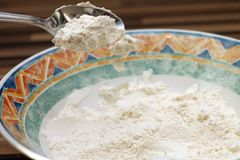 Flour falling from spoon Royalty Free Stock Photo