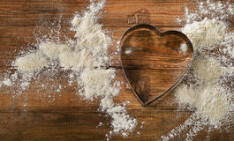 Flour and Heart-shaped cookie cutter Stock Photography