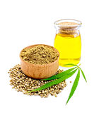 Flour hemp in bowl with grain and oil Royalty Free Stock Photo