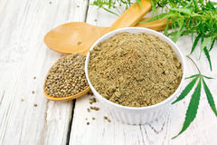 Flour hemp in bowl with spoons on board stock photo