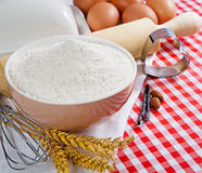 Flour and ingredients for baking in the red checkered tablecloth Royalty Free Stock Photos