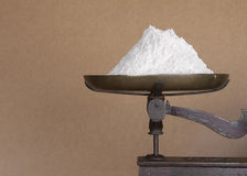 Flour on kitchen scales Stock Images