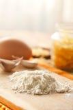 Flour on the kitchen table Stock Photo
