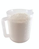 Flour in the measuring cup stock images
