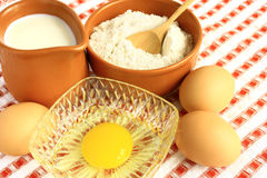 Flour, milk and eggs. On a colored background Stock Image