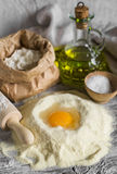 Flour, olive oil, eggs - the ingredients to prepare the dough for pasta Stock Photo