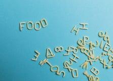 flour pasta on blue background royalty free stock photos