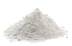 Flour. Pile of wheat flour isolated on white Royalty Free Stock Photo