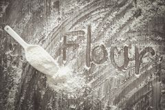 Flour powder and handwrite. Flour powder and handwrite on wood table royalty free stock image