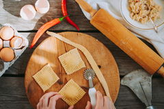Flour process. Ravioli in the making. Stock Photo
