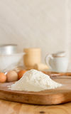 Flour and raw eggs for making dough Royalty Free Stock Photo