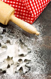 Flour, rolling pin and cookie cutters. Christmas baking. Vintage Royalty Free Stock Photo