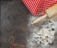 Flour, rolling pin and cookie cutters. Christmas food Royalty Free Stock Photo