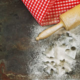 Flour, rolling pin and cookie cutters. Christmas food Stock Images