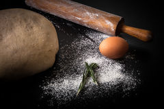 Flour, rolling pin, egg, rosemarin and dough for pie. Toned Royalty Free Stock Photos