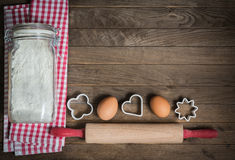 Flour, rolling pin, eggs and moulds Royalty Free Stock Image