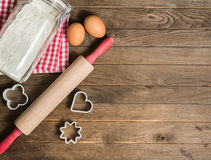 Flour, rolling pin, eggs and moulds Stock Photo