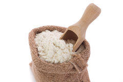 Flour in sack. Flour in burlap sack and wooden spoon Stock Image