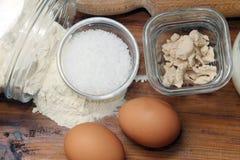Flour, salt, eggs and yeast Stock Photo