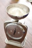 Flour on the scales Stock Photo