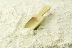 Flour Scoop. Wooden scoop on the white flour pile Stock Photo