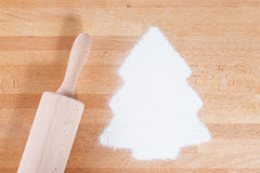 Flour in shape of a christmas tree with a rolling pin Stock Images