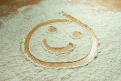 Flour smiley Stock Image