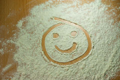 Flour smiley Stock Images