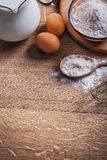 Flour in spoon and bowl eggs pitcher with milk Stock Photos