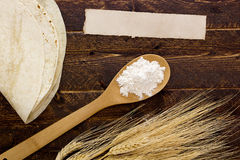 Flour in a spoon and tortillas Royalty Free Stock Photography
