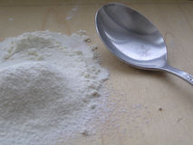 Flour with a spoon Stock Images