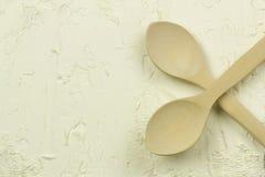 Flour Spoon. Wooden spoons on the white flour pile Stock Image