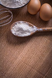 Flour in sppon corolla eggs on vintage wooden Stock Photography