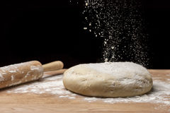 Flour sprinkled on dough. Royalty Free Stock Image