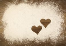 Flour on the table with hearts stock photo