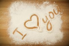 Flour on the table with text I LOVE YOU stock photography