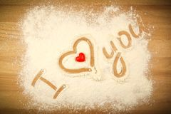 Flour on the table with text I LOVE YOU royalty free stock images