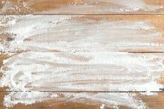 Flour on table. Wheat flour on wooden table Royalty Free Stock Photo