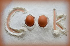 Flour and two eggs Royalty Free Stock Photo