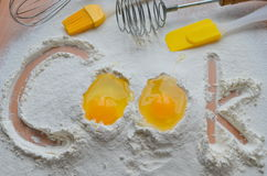 Flour and two eggs Stock Images