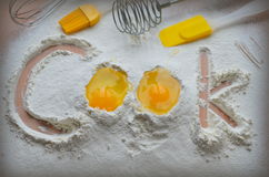 Flour and two eggs. The inscription Cook royalty free stock photography