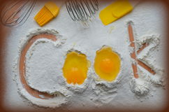 Flour and two eggs. The inscription Cook royalty free stock images