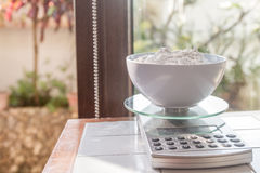 Flour on weighing scale. Flour on a weighing scale royalty free stock images