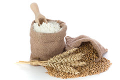 Flour and wheat. Wheat and flour in small burlap sacks Royalty Free Stock Images