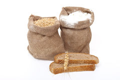 Flour and wheat grain with bread Stock Images