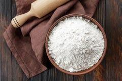 Flour. White flour in a bowl Royalty Free Stock Photos